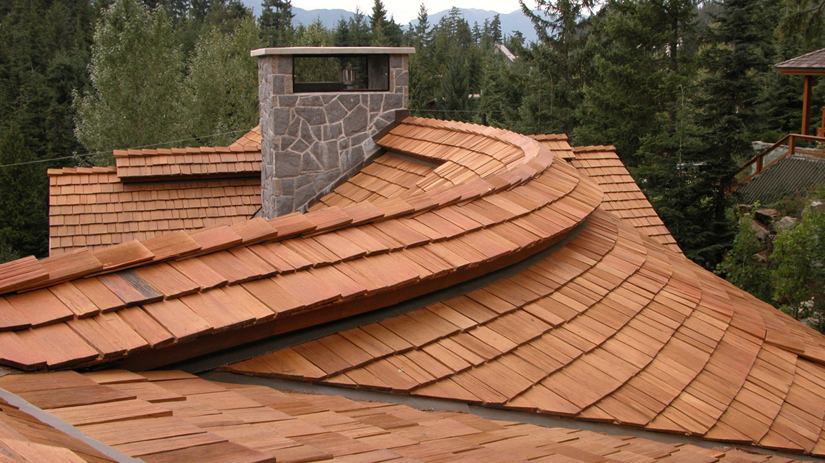 a cedar shake roofing top with a chimney